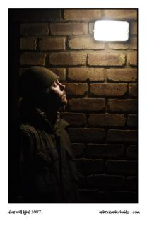 Bradley Jones standing under a light on a wall photographed by Marcus Maschwitz