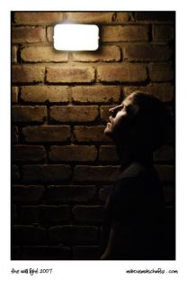 Alan Shenton standing under a light on a wall photographed by Marcus Maschwitz