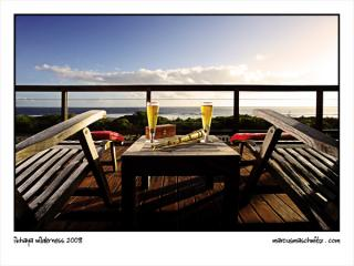 Beers on the balcony at iKhaya Wilderness luxury guest house in Kleinkrantz overlooking the ocean photographed by Marcus Maschwitz