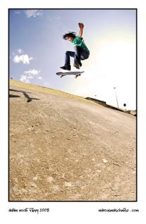 Adam Woolf kick flipping in the drains on 14th avenue in roodepoort photographed by marcus maschwitz