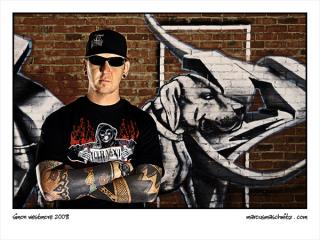 Simon Westmore standing by a wall of graffiti in new town johannesburg photographed by marcus maschwitz