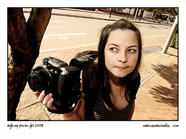 Anja Pomeroy shooting photographs with a Nikon D200 in Newtown Johannesburg photographed by Marcus Maschwitz