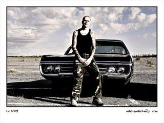 Portrait of a hard core guy sitting on his bonnet at the driving photographed by marcus maschwitz