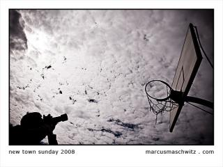 A photographer taking a picture of a basketball hoop photographed by Marcus Maschwitz