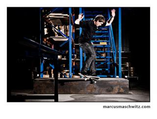 rudi jeggle crooked grind on a box in a warehouse in johannesburg photographed by marcus maschwitz