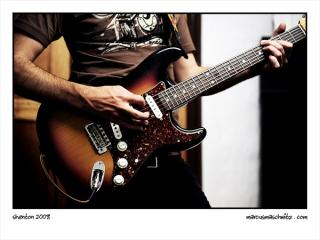 alan shenton rocking the john mayer signature fender guitar at a zebra and giraffe band practice photographed by marcus maschwitz