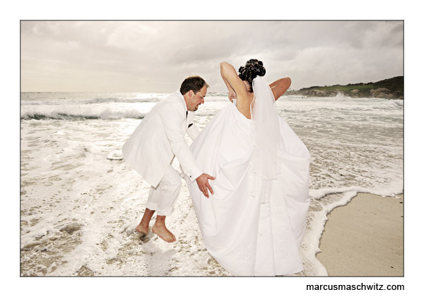 wedding couple on the beach in camps bay photographed by marcus maschwitz