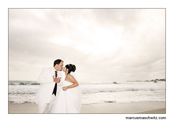 couple kissing on a beach in cape town photographed by marcus maschwitz