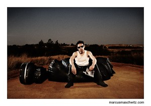 paul e flynn sitting on a leather bean bag chair in the middle of no where photographed by marcus maschwitz
