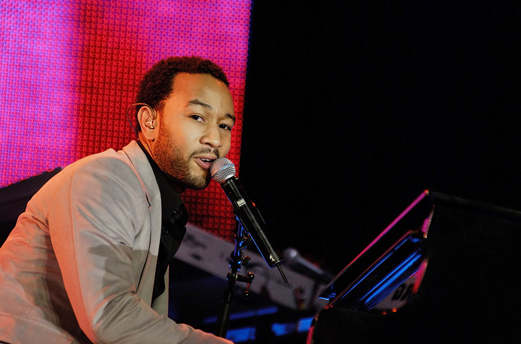 John Legend photographed playing piano live and singing by Marcus Maschwitz