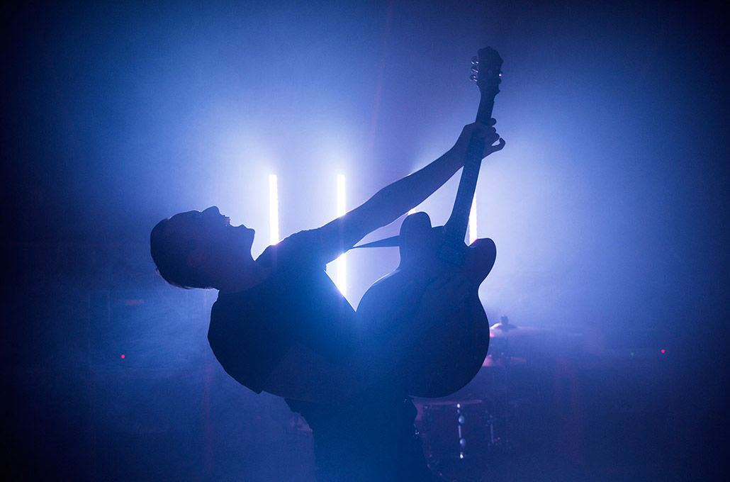 Tyron Layley of New Volume photogaphed perfoming on stage by Marcus Maschwitz