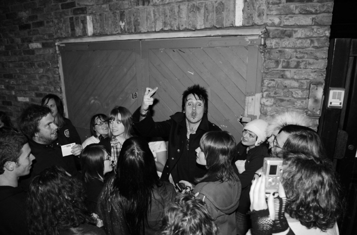 Jacoby Shaddix of Papa Roach photographed backstage hanging with fans by Marcus Maschwitz