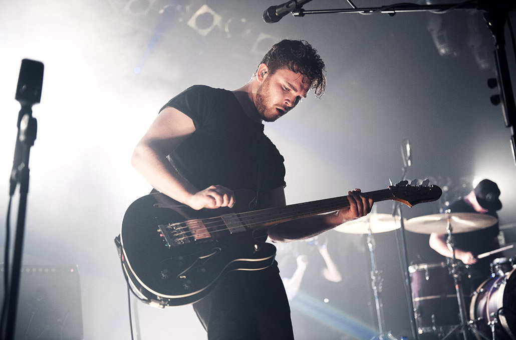 Mike Kerr of Royal Blood photographed playing guitar by Marcus Maschwitz