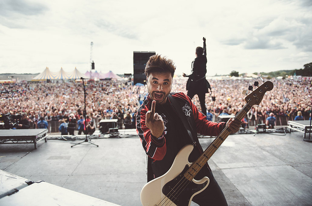 Simon Mitchell of Young Guns photographed live on stage at a festival by Marcus Maschwitz