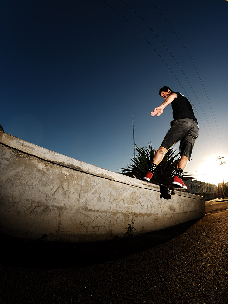 Clayton Petersen FS boardslides on a ledge in Mauritius