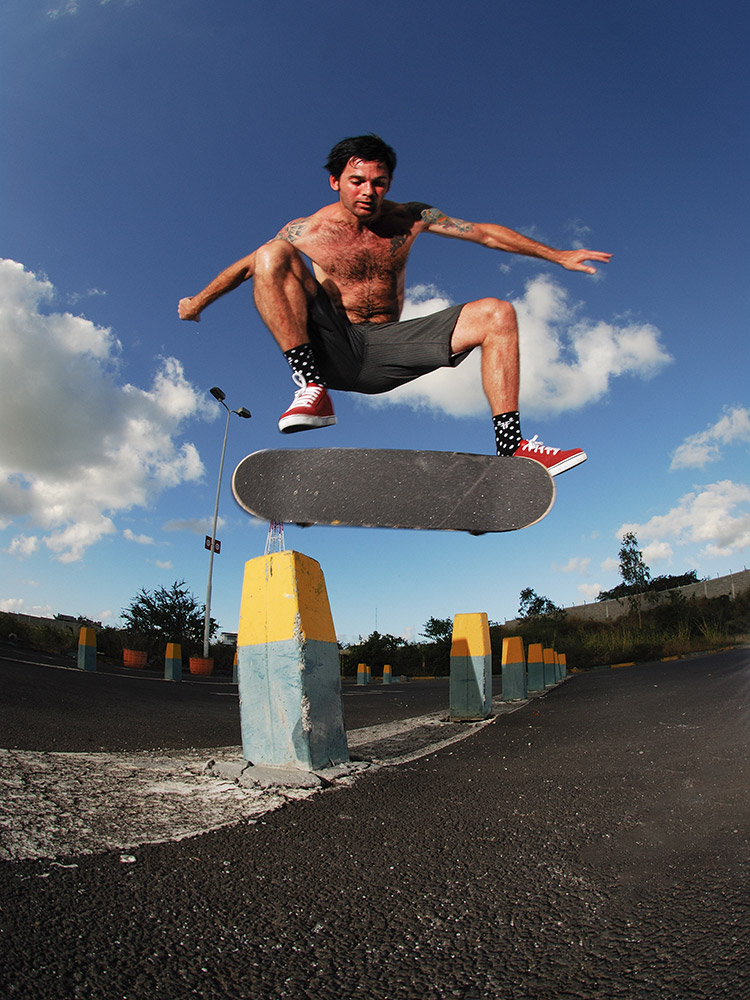 Clayton Petersen kickflips over a pillar in Mauritius