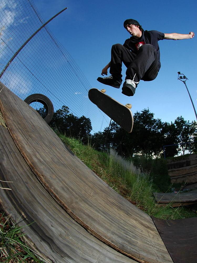 Dean Marais kickflips on a make shift bank in Johannesburg