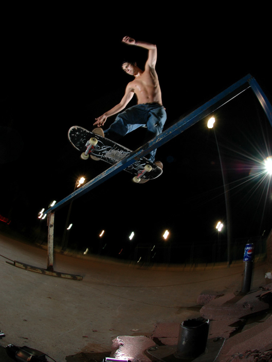 Jordan frontside boardslides a rail in Pretoria