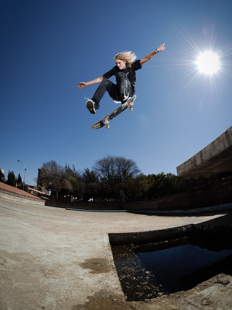 JP Du Preez one footer ollie off a ledge and over a pond in Bloemfontein