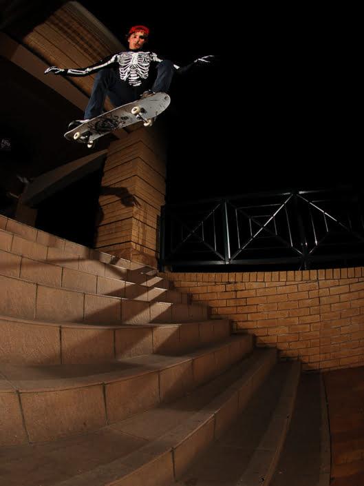 Kyfie Kruger ollies a stair set dressed as a skeleton in Bloemfontein
