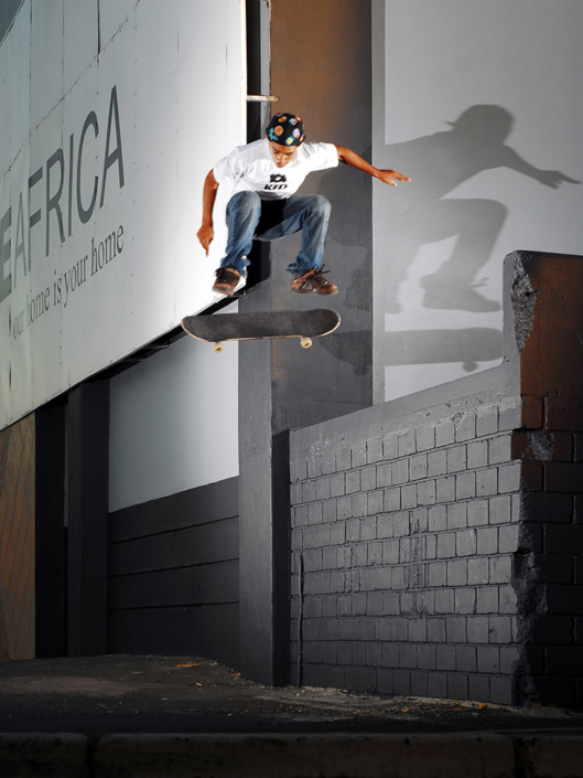 Moses Adams fakie flips off a loading dock in Cape Town