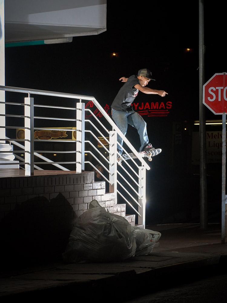 Moses Adams frontside boardslides a handrail in Melville