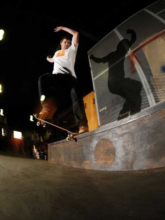 Rudi Jeggle crooked grind on a grindbox in a warehouse in Johannesburg