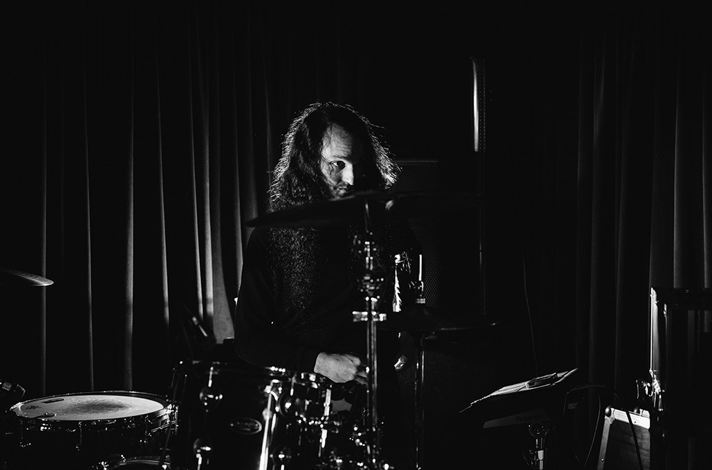 Adam Jenkins drumming during soundcheck photographed by Marcus Maschwitz