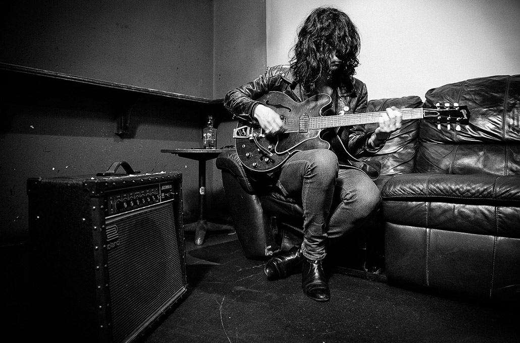 Dan from CUT playing guitar photographed by Marcus Maschwitz