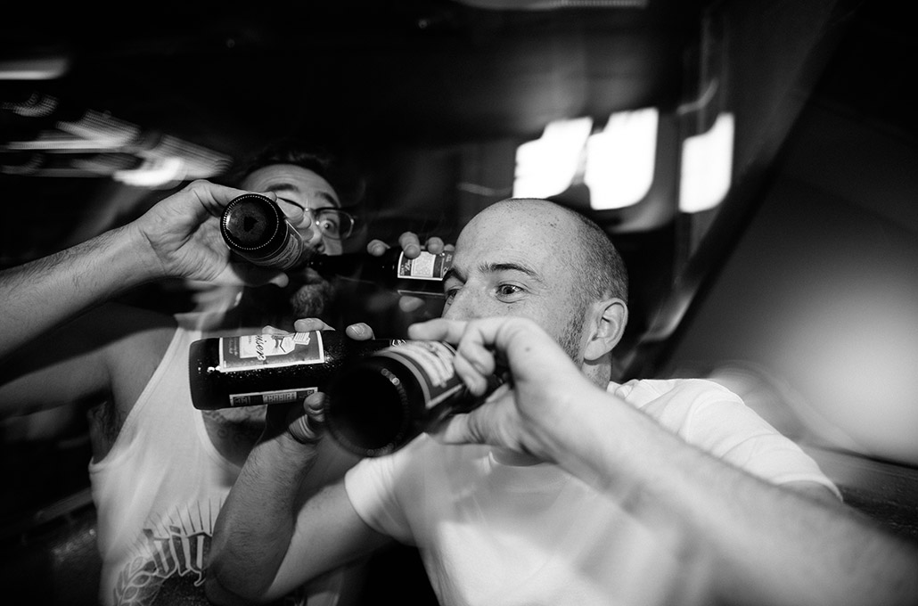 Gavin Butler and James Davies of The Blackout drinking in a club photographed by Marcus Maschwitz