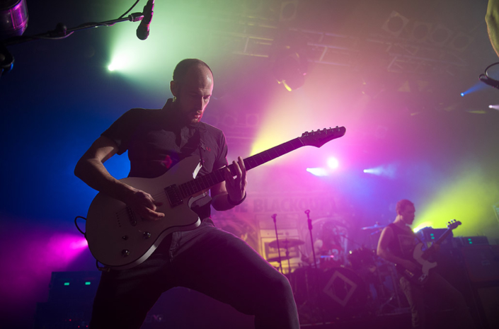 James Davies of The Blackout playing guitar live photographed by Marcus Maschwitz