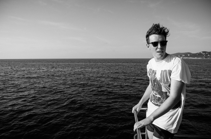 Matthew Davies of The Blackout on a boat in the ocean photographed by Marcus Maschwitz