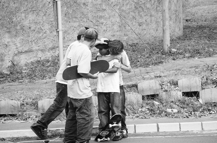 Skateboarders celebrating a land photographed by Marcus Maschwitz