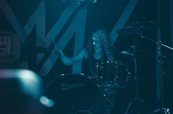 Adam Jenkins of New Voume drumming in blue photographed by Marcus Maschwitz