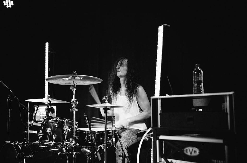 Adam Jenkins of New Volume drumming live on tour