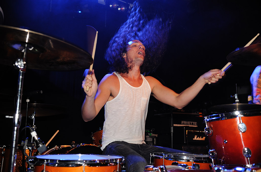 New Volume's Adam Jenkins drumming live photographed by Marcus Maschwitz