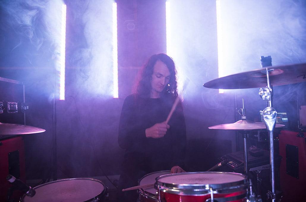 New Volume's drummer Adam Jenkins on set drumming photographed by Marcus Maschwitz