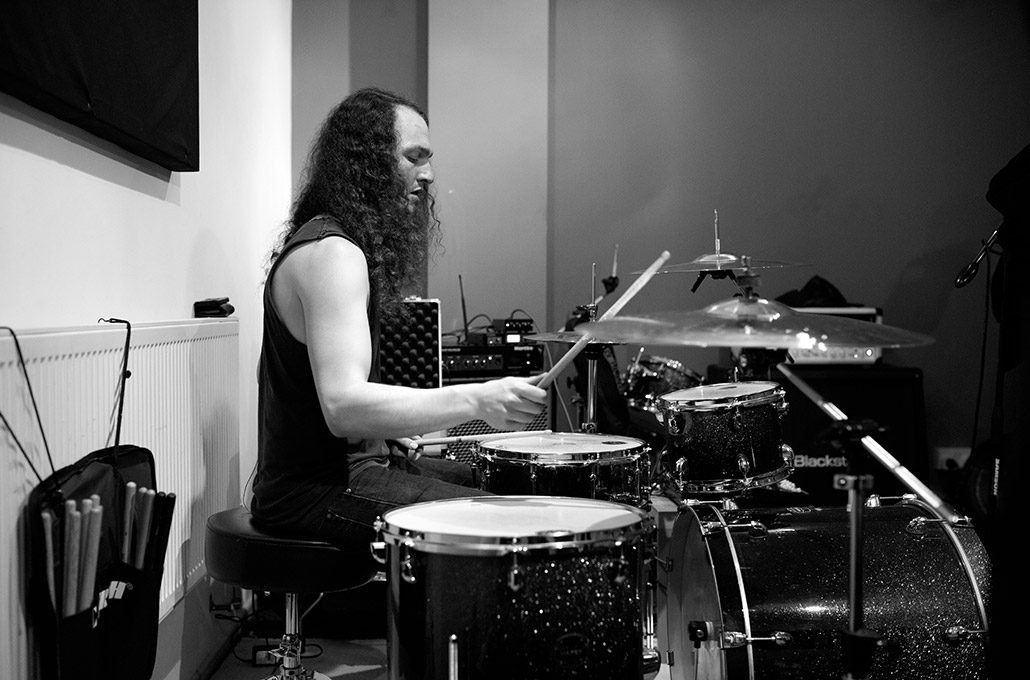 Adam Jenkins drumming during rehearsals photographed by Marcus Maschwitz
