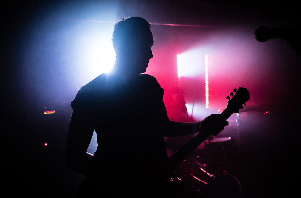 Silhouetted live shot on stage of Tyron Layley photographed by Marcus Maschwitz