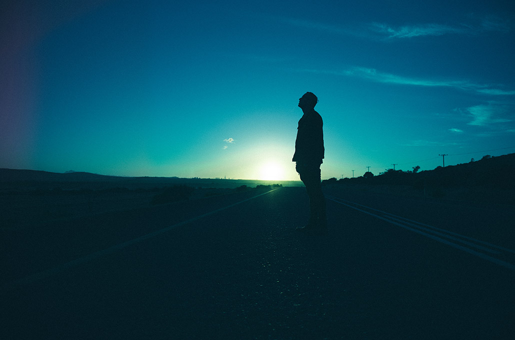 Lifestyle silhouette portrait of Tyron Layley on the road photographed by Marcus Maschwitz