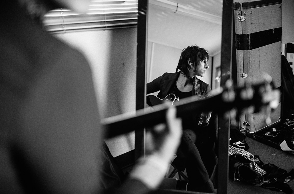 Sebastian Danzig of Palaye Royale warming up on his guitar photographed by Marcus Maschwitz