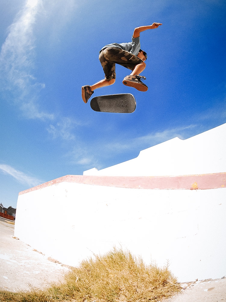 Red Bull skateboarder Moses Adams backside kickflip photographed by Marcus Maschwitz
