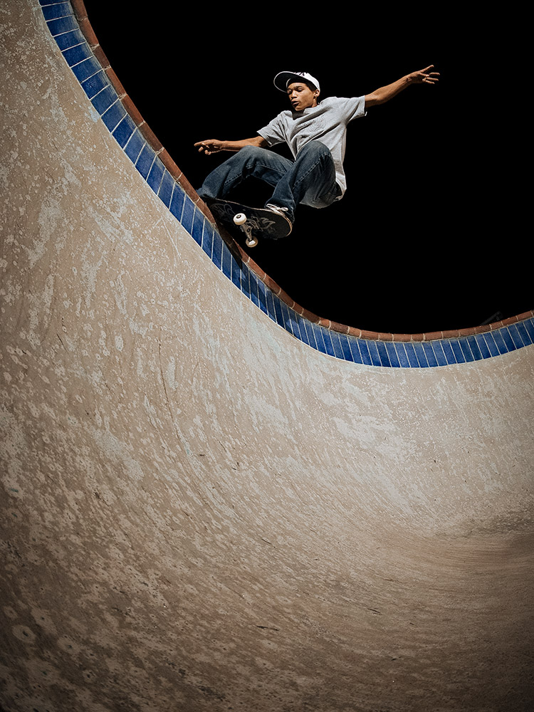 Red Bull skateboarder Moses Adams rock and roll in a swimming pool photographed by Marcus Maschwitz