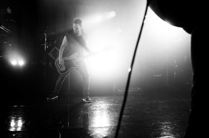 Rhys Lewis of The Blackout playing bass on stage photographed by Marcus Maschwitz