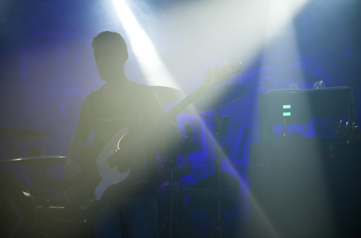 Rhys Lewis of The Blackout silhouetted on stage photographed by Marcus Maschwitz