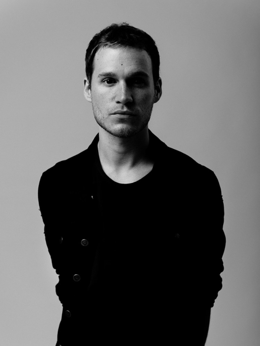 Black and white portrait of Rhys Lewis of The Blackout photographed by Marcus Maschwitz