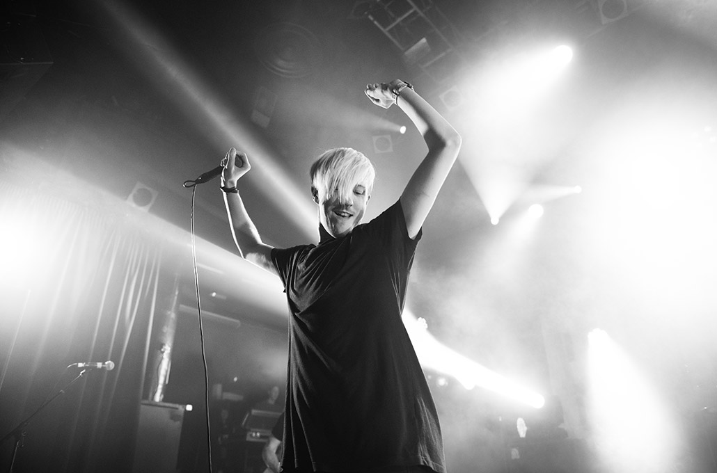 Sean Smith of The Blackout dancing on stage photographed by Marcus Maschwitz