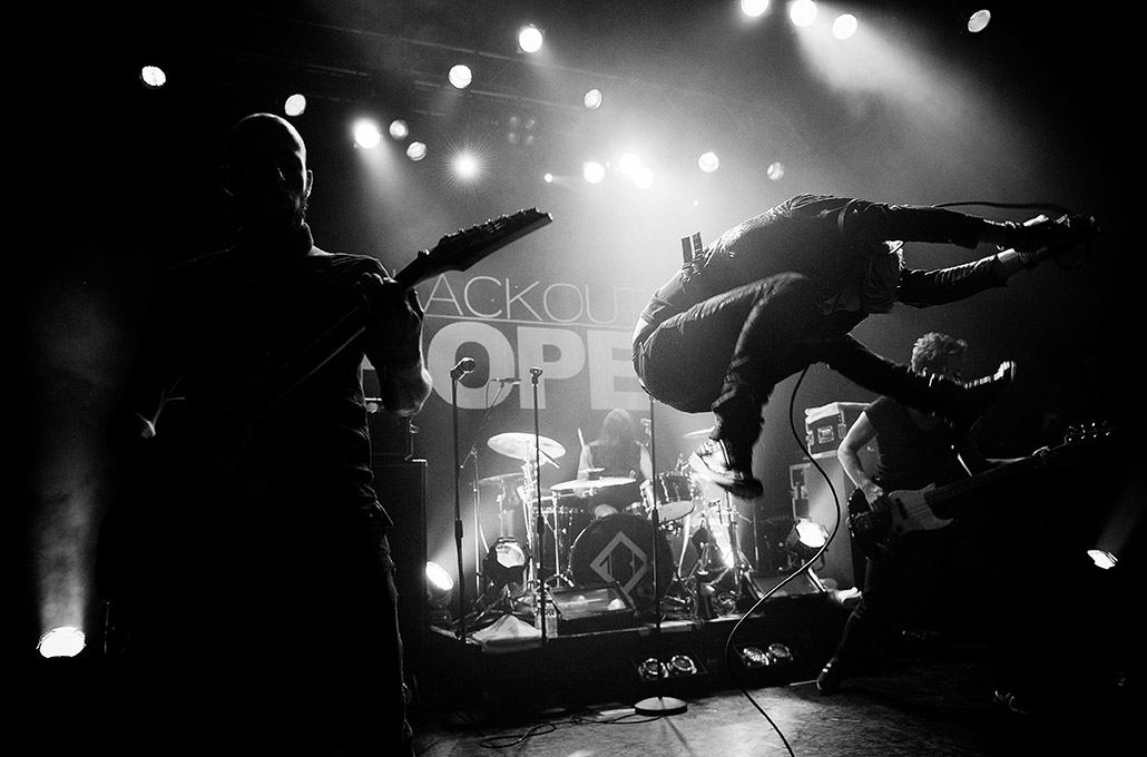 Sean Smith of The Blackout jumping during a live show photographed by Marcus Maschwitz