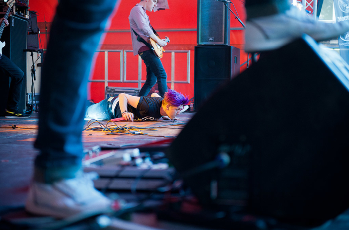 Sean Smith of The Blackout lying on stage at Slam Dunk photographed by Marcus Maschwitz