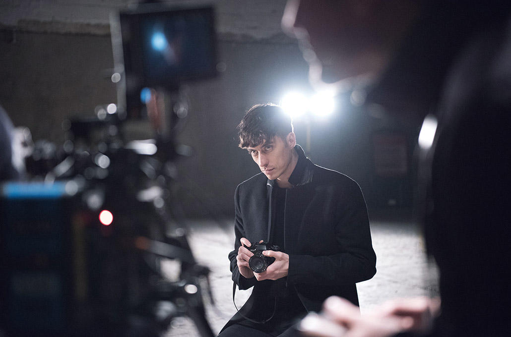 Gustav Wood of Young Guns playing with a camera on set photographed by Marcus Maschwitz